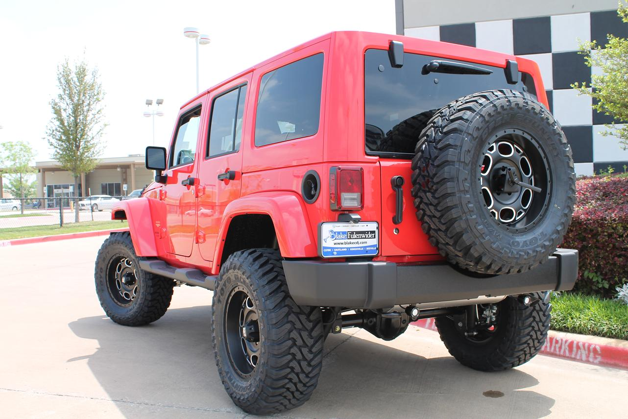 Picture 18 inch xd series wheels with toyo tires in a red wrangler